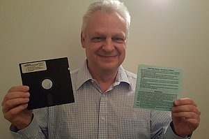 Eddy Willems holding a diskette with the AIDS ransomware